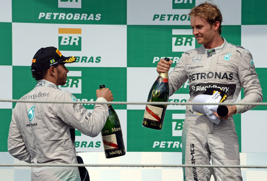 Title contenders Nico Rosberg and Lewis Hamilton acknowledge each other on the podium