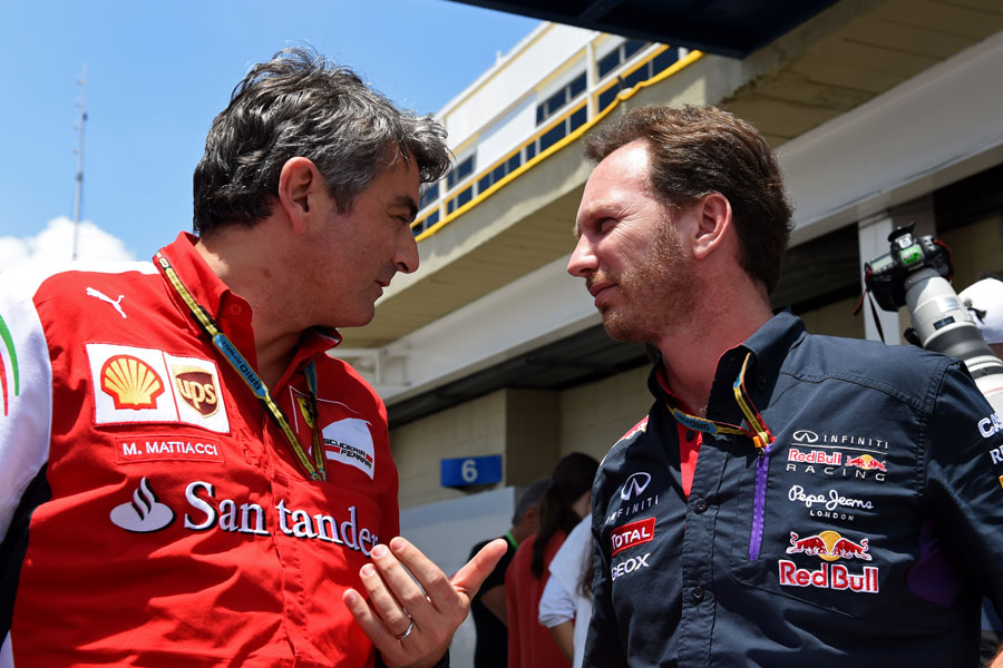 Marco Mattiacci and Christian Horner discuss matters in the paddock