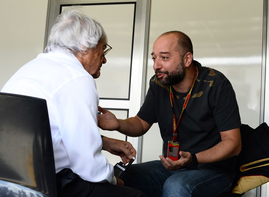 Bernie Ecclestone talks with Lotus boss Gerard Lopez