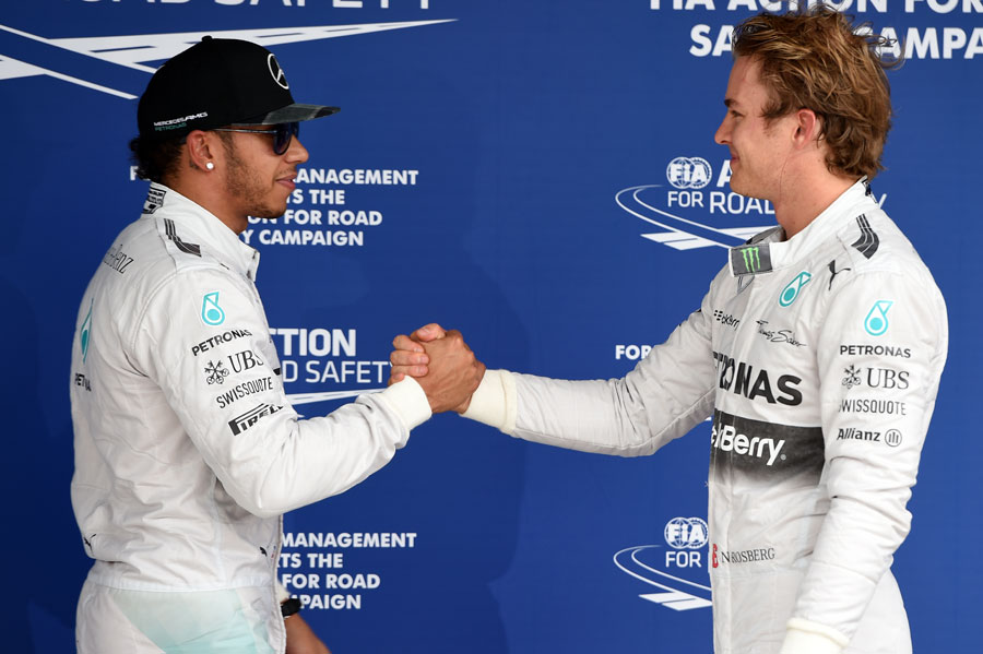 Lewis Hamilton congratulates Nico Rosberg on pole position