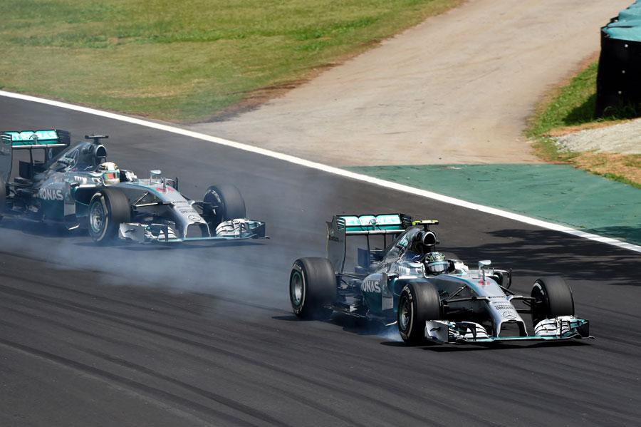 Nico Rosberg locks up under pressure from Lewis Hamilton
