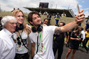 Brazilian footballer Alexandre Pato poses for a selfie with Bernie Ecclestone