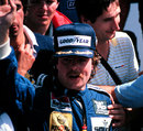 Keke Rosberg celebrates his maiden grand prix victory
