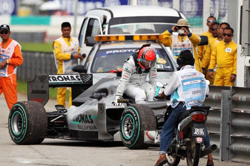 Michael Schumacher retires from the Malaysian Grand Prix