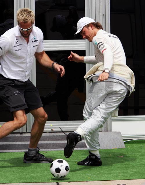 Nico Rosberg plays football with his trainer