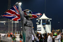 Lewis Hamilton celebrates with the British flag in parc ferme