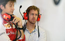 Sebastian Vettel watches on in the Ferrari garage