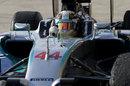 Lewis Hamilton celebrates victory as he pulls into parc ferme