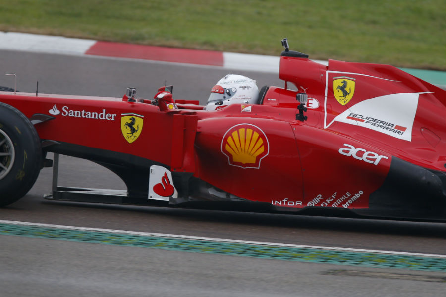 Sebastian Vettel behind the wheel of the Ferrari F2012