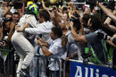 Felipe Massa celebrates second by leaping into the arms of his mechanics in parc ferme