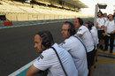 McLaren mechanics wait in vain for a sight of Stoffel Vandoorne