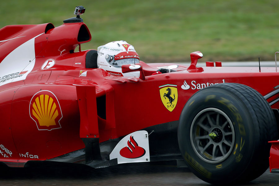 Sebastian Vettel behind the wheel of a 2012 Ferrari at Fiorano