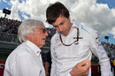 Bernie Ecclestone speaks to Mercedes boss Toto Wolff on the grid