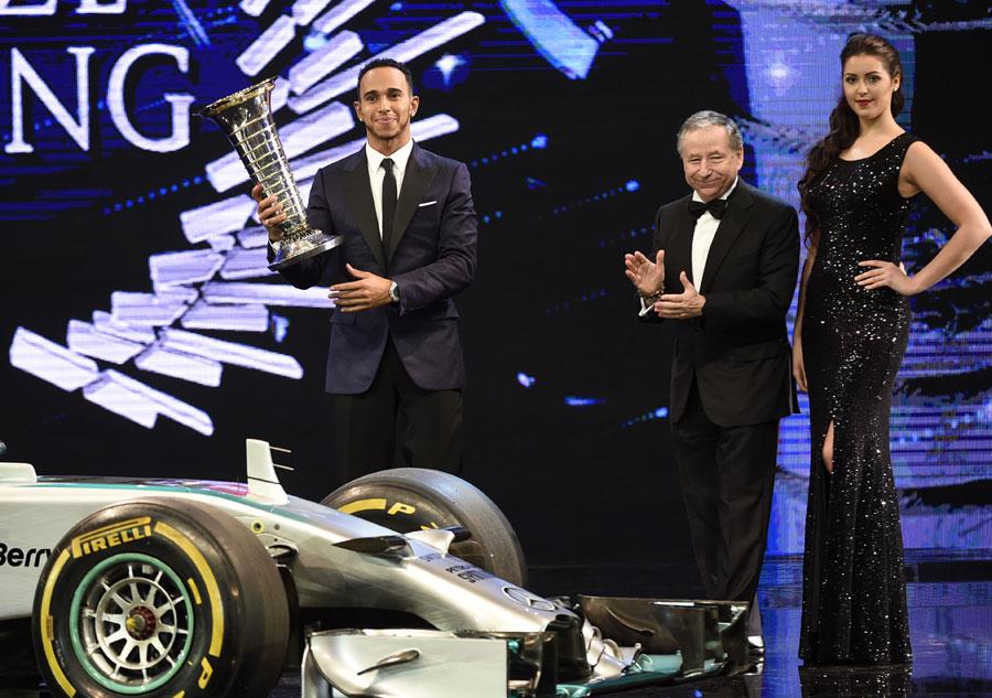 Lewis Hamilton receives his world drivers' championship trophy
