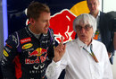 Bernie Ecclestone pays a visit to Sebastian Vettel in the Red Bull garage