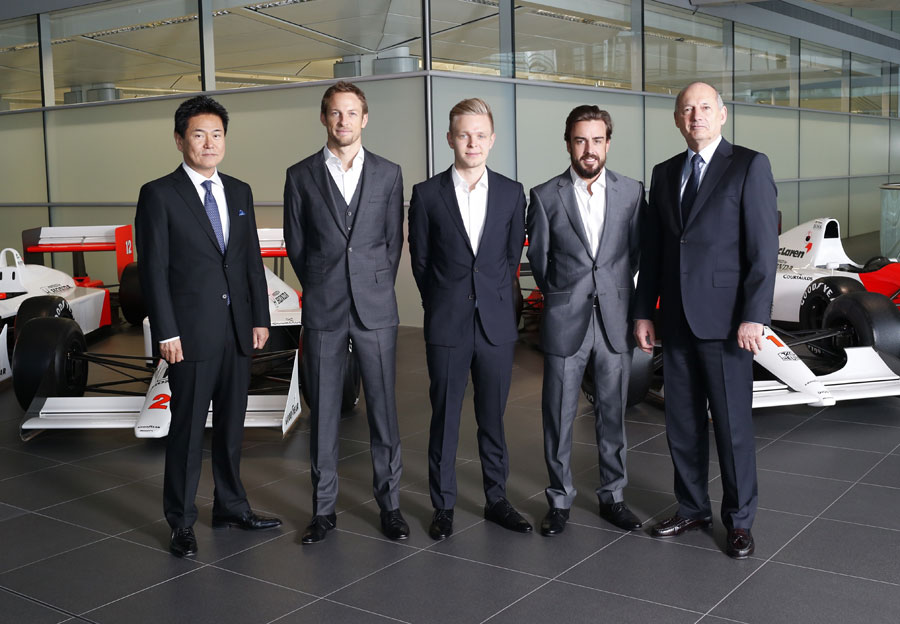 Yasuhisa Arai of Honda, Jenson Button, Kevin Magnussen, Fernando Alonso and Ron Dennis pose for a photo