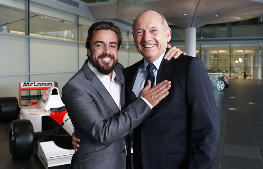 New McLaren signing Fernando Alonso poses with CEO Ron Dennis