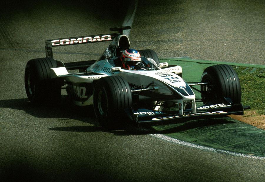 Jenson Button rides the kerbs