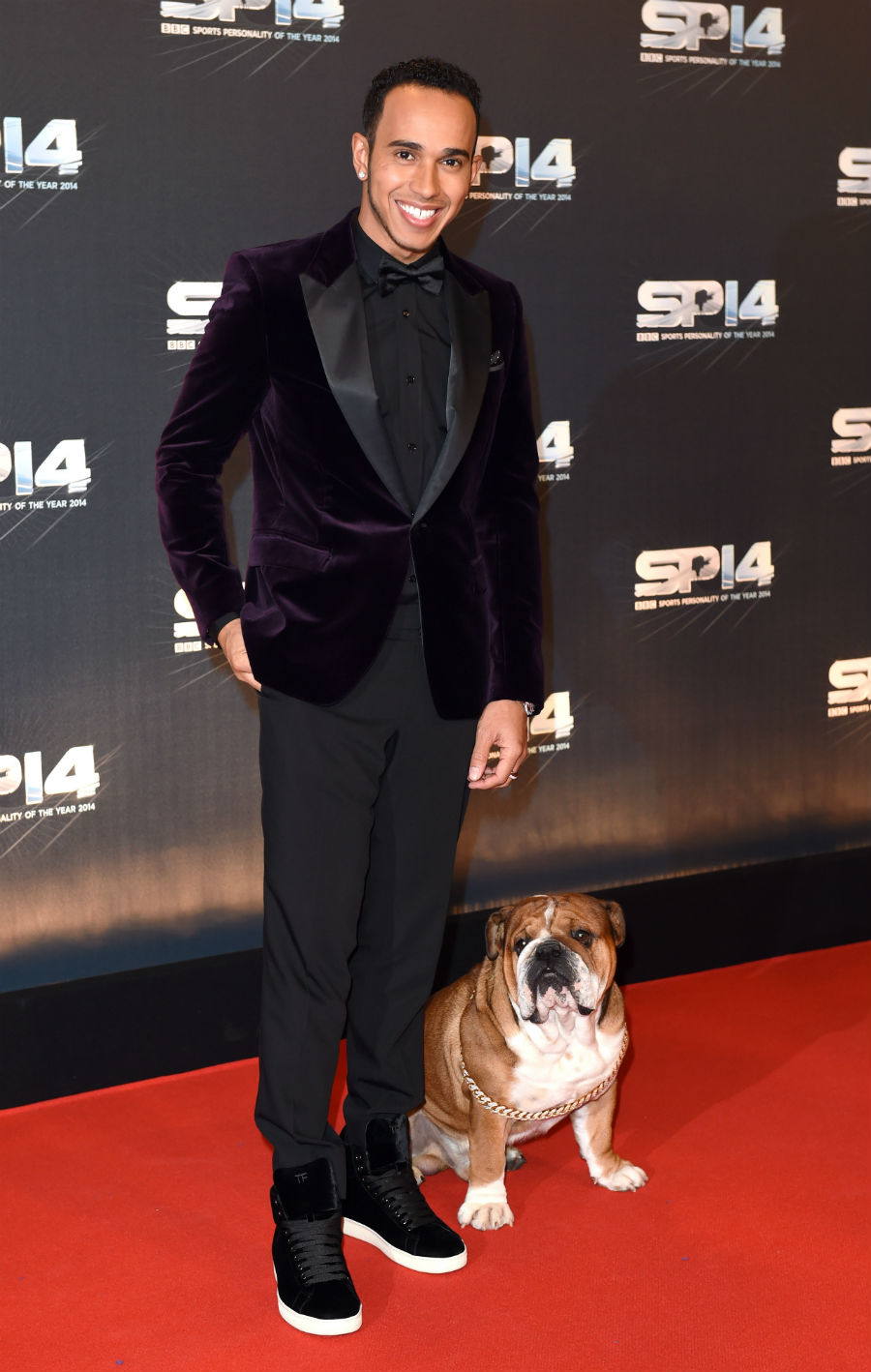 Lewis Hamilton and his dog Roscoe pose for the cameras ahead of the BBC Sports Personality of the Year award ceremony