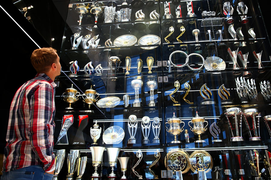 Sebastian Vettel looks at Red Bull's trophy cabinet in Milton Keynes during his farewell to the team