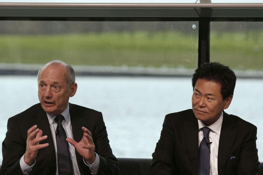 Ron Dennis and Yasuhisa Arai speak top the press