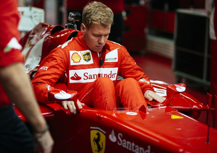 Sebastian Vettel lowers himself into the Ferrari F2012
