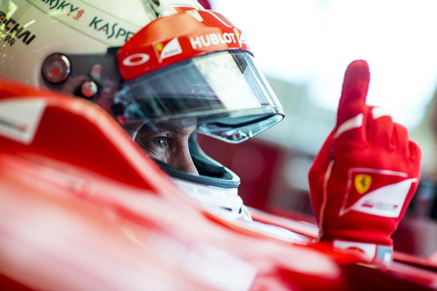Sebastian Vettel asks his engineers to fire up his Ferrari