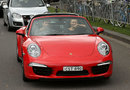 Ex-F1 driver Mark Webber gives Maria Sharapova a lift through the streets of Melbourne to tennis practice in a Porsche 911