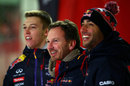 Red Bull boss Christian Horner poses with team drivers Daniil Kvyat and Daniel Ricciardo at a media event in Milton Keynes