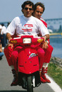 Ayrton Senna gives Gerhard Berger a lift back to the pits