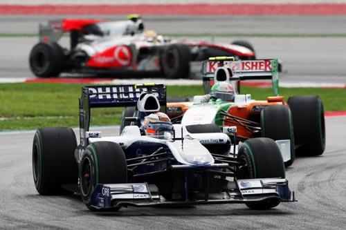 Nico Hulkenberg leads Tonio Liuzzi and Lewis Hamilton