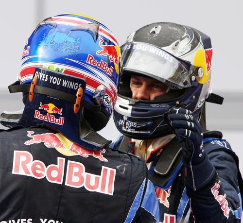 Mark Webber congratulates Sebastian Vettel