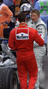 Michael Schumacher commiserates with Mika Hakkinen