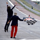Ferrari boss Luca di Montezemolo jumps for joy as Niki Lauda crosses the finish line