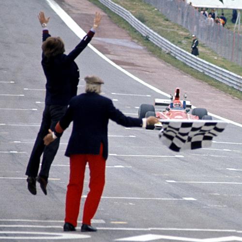 Ferrari boss Luca di Montezemolo jumps for joy as Niki Lauda crosses the finish line
