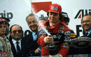 Race winner Didier Pironi sprays the champagne