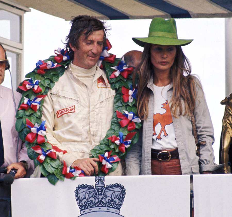 Jochen Rindt celebrates a hat trick of victories on the podium