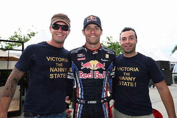 Mark Webber poses for a photo with Australian fans