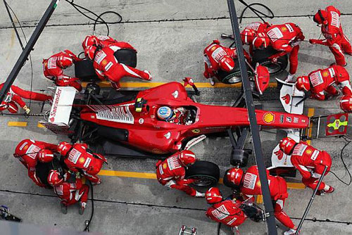 Fernando Alonso makes a pit stop