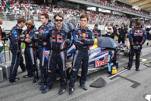 Red Bull mechanics block the view of the back of the RB6