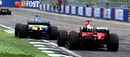 Fernando Alonso crosses the finish line ahead of Michael Schumacher