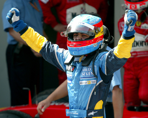 Fernando Alonso celebrates after taking second place