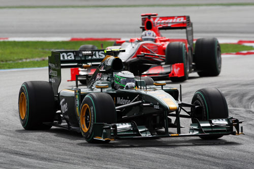 Heikki Kovalainen leads the Virgin of Timo Glock