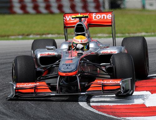 Lewis Hamilton hits the apex in his McLaren