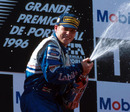 Jacques Villeneuve celebrates his race win