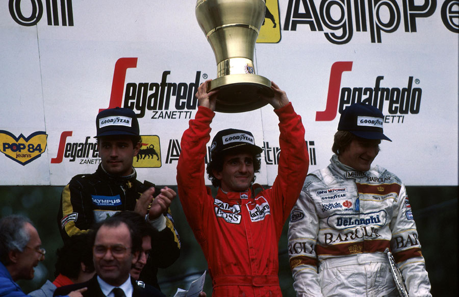 Winner Alain Prost, second-placed Elio de Angelis and third-placed Thierry Boutsen