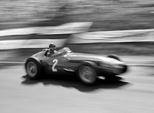 Juan Manuel Fangio on his way to winning the 1957 French Grand Prix