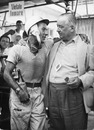 Stirling Moss celebrates winning the 1957 Pescara Grand Prix with Tony Vanderwell, designer of his winning Vanwall
