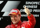 Rubens Barrichello celebrates winning the inaugural Chinese Grand Prix