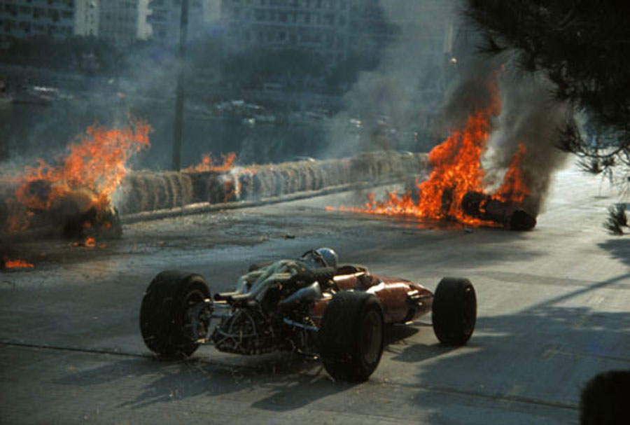 Chris Amon passes the horrifying crash of his team-mate Lorenzo Bandini